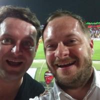 Daniel (right) with Darel watching Al Ahli Dubai v Tractor Sazi in the AFC Champions League