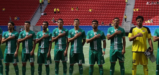 Iraq players line up before an empty stadium in Brazil